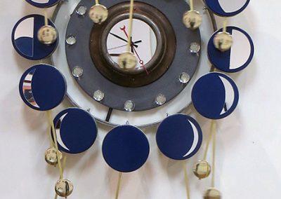 "Randall Cleaver -""Moon Days Times 2"" cookie tins, bike rim, metal plate, grill pan, plastic balls, ""L"" brackets, brass plumbing part, new pendulum and clock movements"