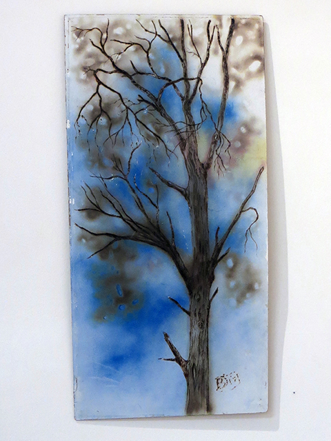 "Brian McCormack   ""Scorched Tree on Blue"" torch, pyro detailer, paint on scrap wood fro Ikea furniture"