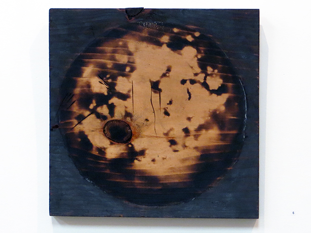 "Brian McCormack ""Planet Forming"" torched scrap wood"