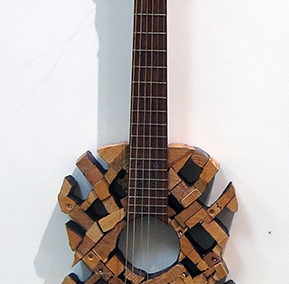"""Amy Puccio  """"Fender Bender"""" wood mosaic wall relief, mixed media, $800.00"""