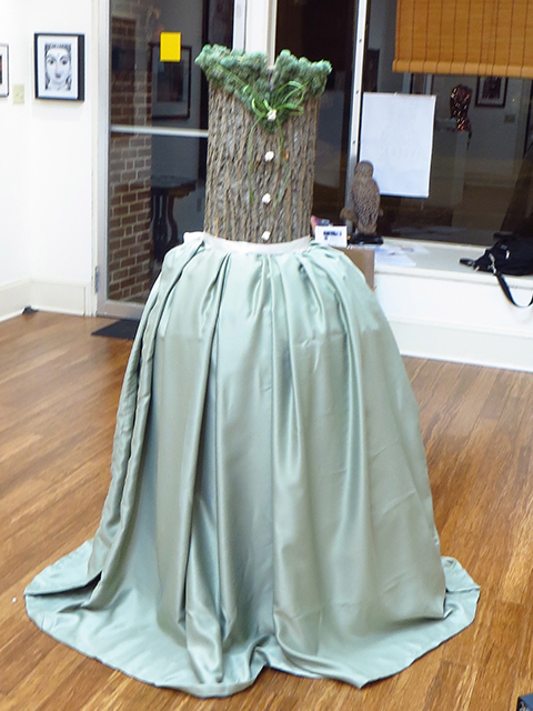 "Lora Hudicka  – ""One Whimsical Dance"" sculpture – hollowed tree trunk, silk ribbon, dried moss, flowers, fabric"