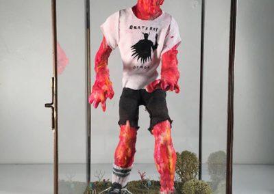 "Alan Brown ""The Return of Bobby Trentino"" – Paper clay, wax, crayon, fabric, wood, cardboard, moss, diorama miniatures, acrylic"