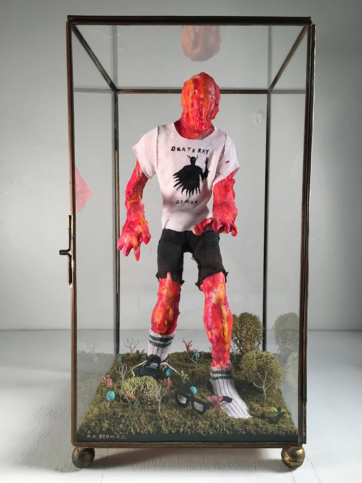 "Alan Brown ""The Return of Bobby Trentino"" – Paper clay, wax, crayon, fabric, wood, cardboard, moss, diorama miniatures, acrylic"