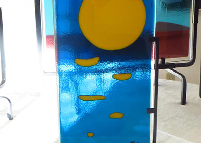 "Ellen Rebarber   ""Moon Over Maine"" Fused glass with yellow on transparent blue"