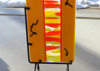 "Ellen Rebarber   ""Secret Message"" Fused yellow glass with red, orange, white and black"