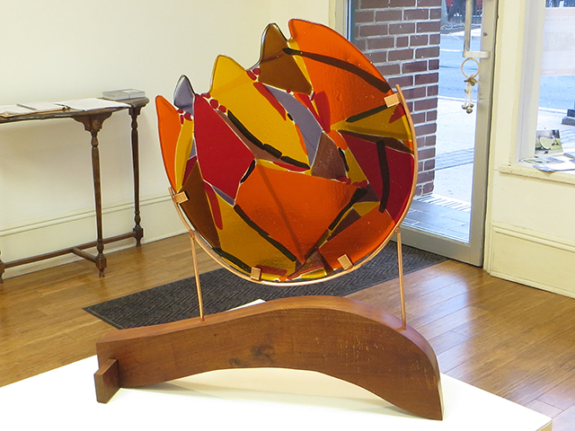"""Fireball""   fused glass, copper and wood by Ellen Rebarber"