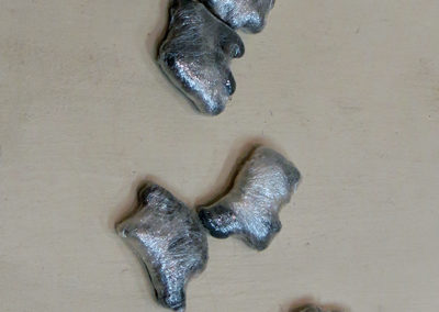 """Animal Crackers"" animal crackers painted gray wrapped in plastic, 1.5"" x 1"" each $80.00"