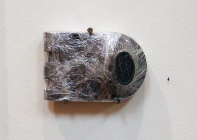 """Deadbolt"" deadbolt painted gray wrapped in plastic,  4.5"" x 3"" x 1"" $120.00"