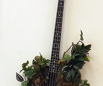 Green Man Bass – found electric guitar bass parts, faux plant material, tree branch cuttings, paint