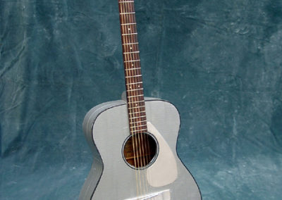 Duct Tape Guitar – found guitar busted open in the back, repaired adduct taped and silver paint on neck