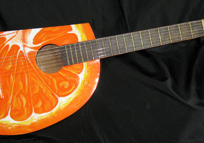 Orange Slice Guitar – found acoustic guitar, guitar body parts, bondo body filler, paint