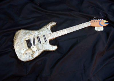 Smell-A-Caster – found electric guitar body, electric guitar parts, handmade neck and body plated with sardine cans, reflective vinyl fish scales