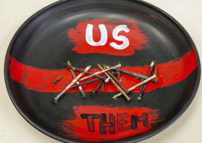 """Dina Robinson """"Us/Them"""" wheel thrown glazed porcelain platter with hand colored elements, 14″ dia. – $100.00"""