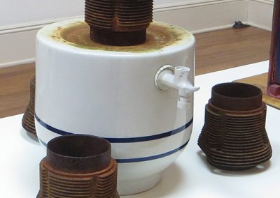 "Fred Cole ""Corrosive Elements"" recycled ceramic water receptacle, engine cylinder heads"