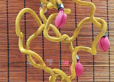 "Fred Cole  – ""Eight Yellow Appendages"" recycled gas line, castors, plastic tips"