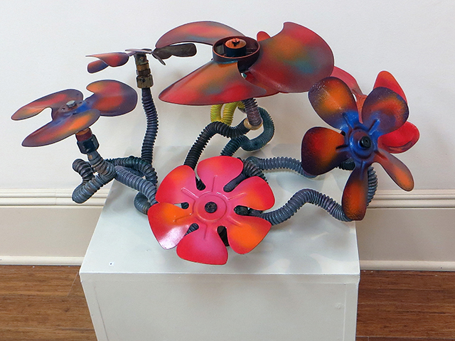 "Fred Cole -""Floral Arrangement"" recycled gas lines and motor fans"