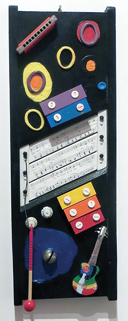 """Fred Cole -""""Music Doth have Ears"""" recycled cutting board, musical toys and instruments"""
