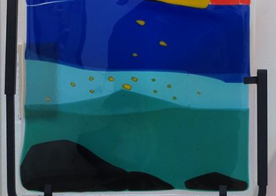 "Ellen Rebarber – ""Moon over the Mountain"" fused glass with various colors"
