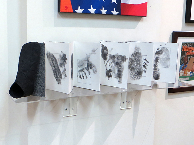"""Pat Feeney-Murrell """"A Book of Soles"""" accordion book of lithographic transfer imprints of a foot, top, sides, sole textures, flax handmade paper book cover and cast foot, $2,000.00"""