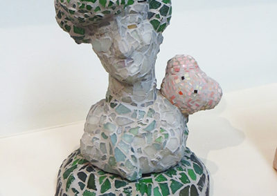 "Judith Hugentobler  – ""Sentimental Lady with a Small Bear"" stoneware, tile, glass and grout"