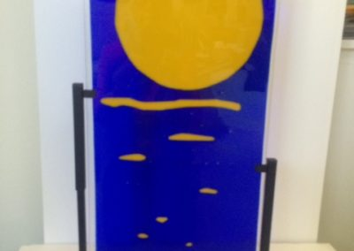 "Ellen Rebarber – ""Moonlight Solitude"" fused glass with various colors"