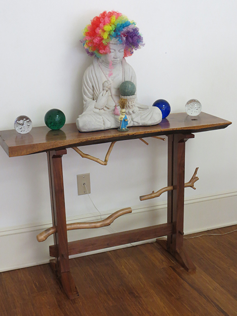 "John Marron  – ""Rainbow Buddha Wigging Out"" installation with black walnut altar table by Phil George"