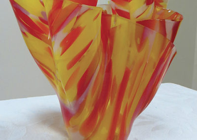 "Ellen Rebarber  ""Draped Vessel""  Slumped glass in red, yellow, white and clear"