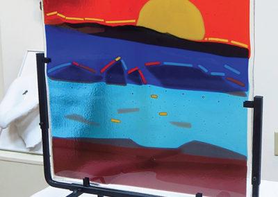 "Ellen Rebarber   ""Sunrise ""  Fused glass in many colors"