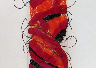 """Don't fence me in""   fused glass and copper wire and wood,  by Ellen Rebarber"