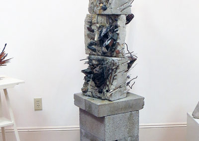 """""""Guardian""""  mortar, found objects on cinder blocks, by Eric Beckerich"""