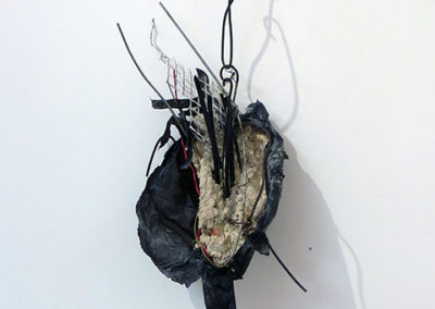 """In Time"" mortar, wire, paper and found objects, by Eric Beckerich"
