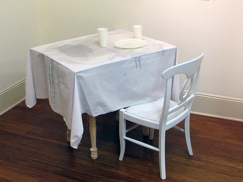 """""""Family Dinner""""   wood, chair, heat lamps, sheetmetal, wax on fabric,  36"""" x 34"""" x 31"""" Price on request"""