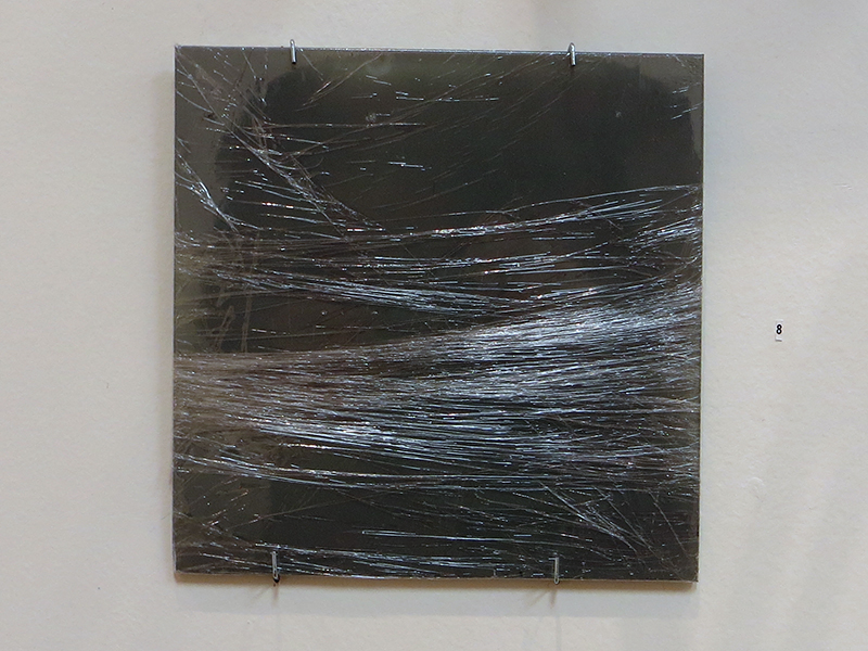 """""""Floor Tile""""   floor tile painted gray wrapped in plastic, 7.75"""" x .25"""" x 7.75"""",  $80.00"""