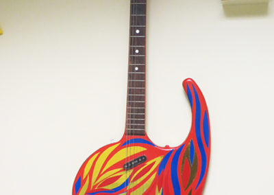 Comma Guitar – carved oak table leaf, guitar parts, paint, reflective tape