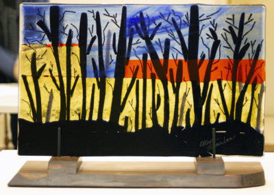 """Ellen Rebarber""""Waiting for the Bulldozer"""" fused glass on Rosewood base,11""""H x 18 1/2""""W, 2020"""