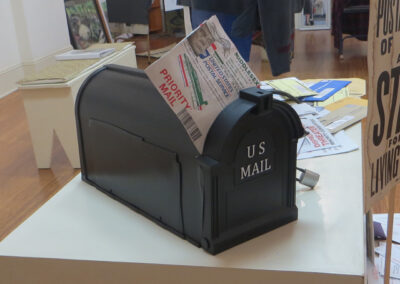 """Fred Cole """"Lock Out The Vote"""", mixed media sculpture with mailbox, bicycle locks, & collage $200.00"""