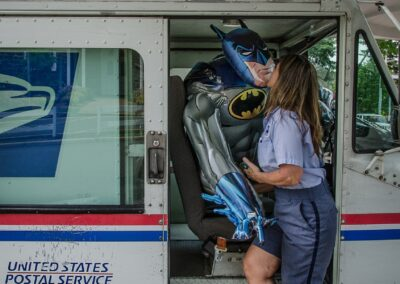 """Christine Anderson """"Postal worker kissing an inflatable Batman"""", photograph, $300.00"""